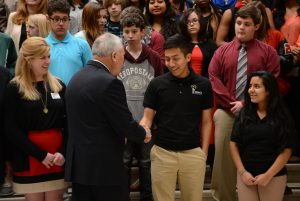Governor Nathan Deal shakes hands with a REACH Scholar