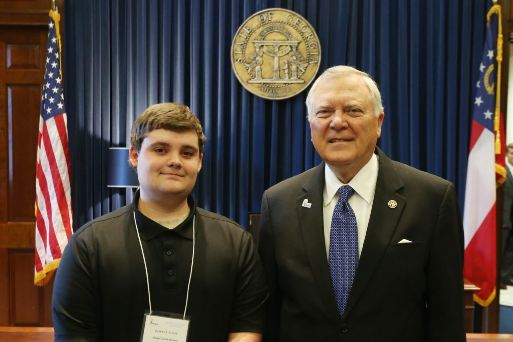 (Pictured from left) REACH Scholar Robert Bush and Governor Nathan Deal